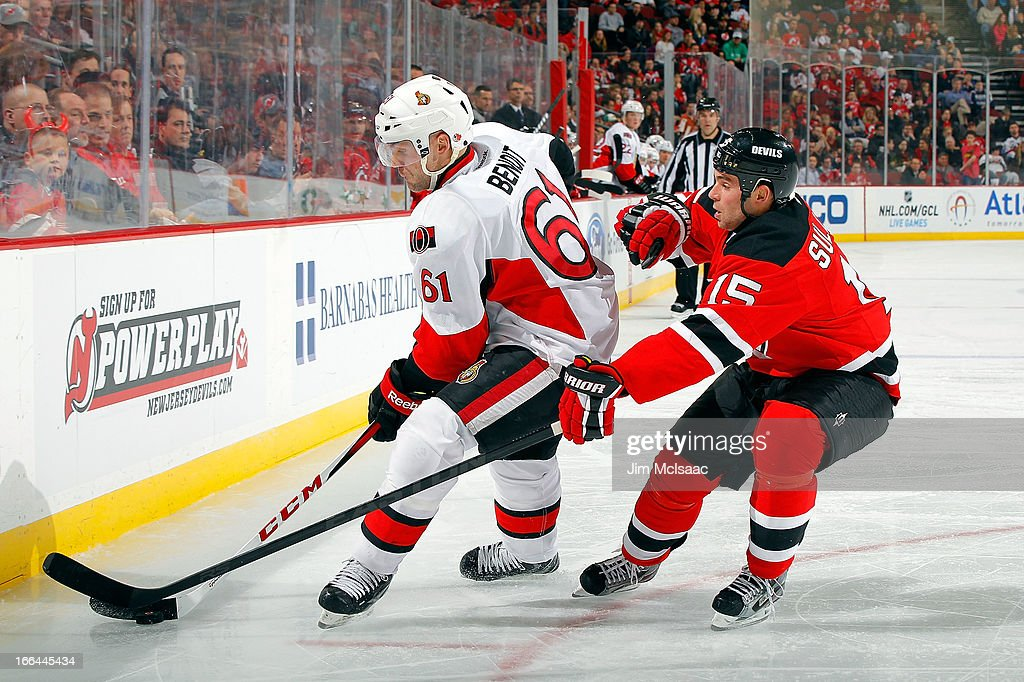 Andre Benoit #61 of the Ottawa Senators plays the puck against <a gi-track='captionPersonalityLinkClicked' href=/galleries/search?phrase=Steve+Sullivan&family=editorial&specificpeople=201723 ng-click='$event.stopPropagation()'>Steve Sullivan</a> #15 of the New Jersey Devils at the Prudential Center on April 12, 2013 in Newark, New Jersey.