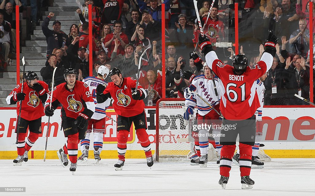 Andre Benoit #61 of the Ottawa Senators raises his arms in celebration of his second-period goal against the New York Rangers with teammates <a gi-track='captionPersonalityLinkClicked' href=/galleries/search?phrase=Jakob+Silfverberg&family=editorial&specificpeople=5894639 ng-click='$event.stopPropagation()'>Jakob Silfverberg</a> #33, <a gi-track='captionPersonalityLinkClicked' href=/galleries/search?phrase=Mika+Zibanejad&family=editorial&specificpeople=7832310 ng-click='$event.stopPropagation()'>Mika Zibanejad</a> and Chris Neil #25 on March 28, 2013 at Scotiabank Place in Ottawa, Ontario, Canada.