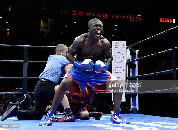 Andre Berto celebrates after knocking out Josesito Lopez in the 6 round of their 12 round welterweight bout at Citizens Business Bank Arena March 13...