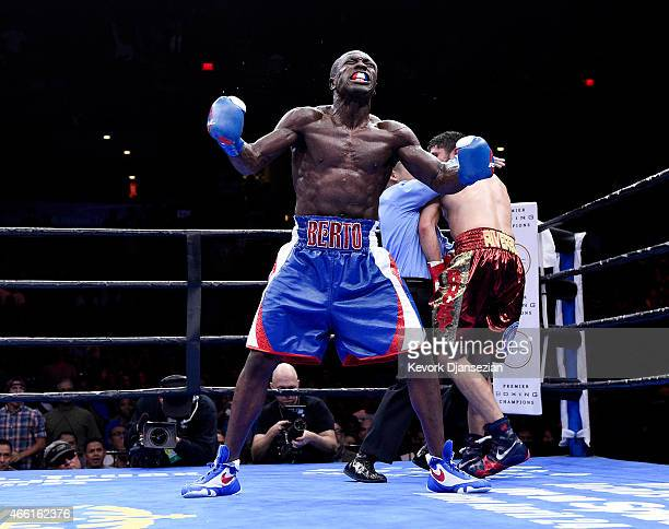 Andre Berto celebrates after knocking out Josesito Lopez in the 6th round of their 12 round welterweight bout at Citizens Business Bank Arena March...