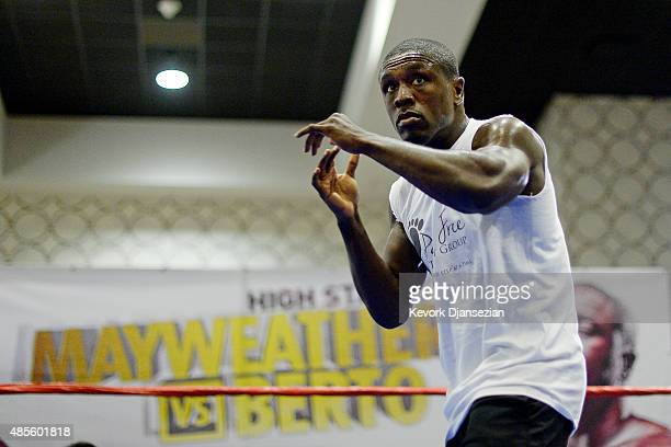 Andre Berto former twotime welterweight world champion spars during a media workout in preparation for his fight against Floyd Mayweather Jr August...