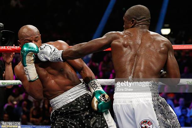 Andre Berto lands a left on Floyd Mayweather Jr during their WBC/WBA welterweight title fight at MGM Grand Garden Arena on September 12 2015 in Las...