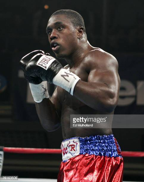 Andre Berto moves forward during his junior middleweight bout against Daniel Neal at Hammerstein Ballroom in New York City Berto remained undefeated...