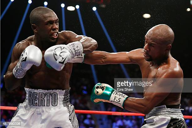 Andre Berto throws a left at Floyd Mayweather Jr during their WBC/WBA welterweight title fight at MGM Grand Garden Arena on September 12 2015 in Las...