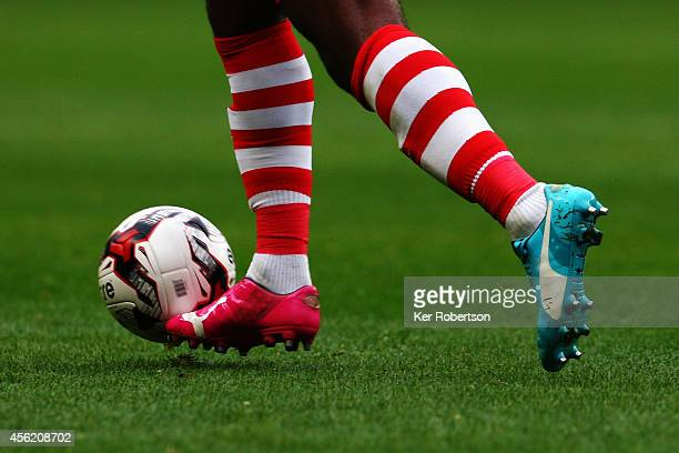 Andre BikeyAmougou of Charlton Athletic runs with the ball while wearing two differently coloured boots during the Sky Bet Championship match between...