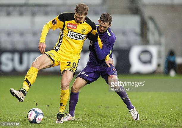 Andre Bjerregaard of AC Horsens and Kian Hansen of FC Midtjylland compete for the ball during the Danish Alka Superliga match between AC Horsens and...