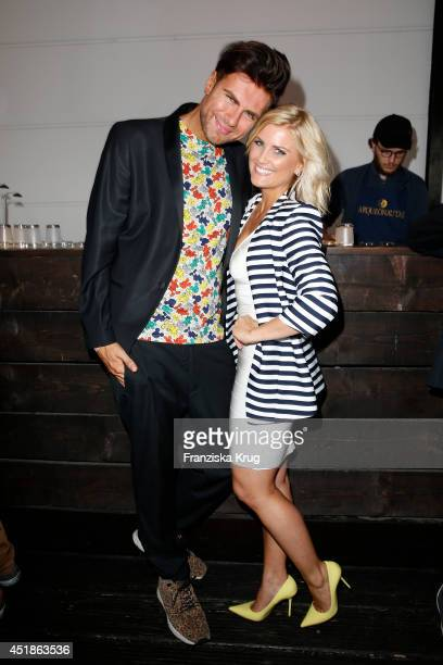Andre Borchers and Jennifer Knaeble attend the Arqueonautas Presents Kevin Costner Music Meets Fashion at Spindler Klatt on July 08 2014 in Berlin...