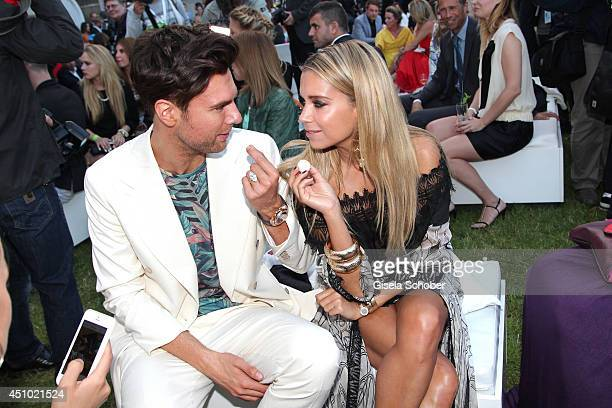 Andre Borchers and Sylvie Meis attend the Raffaello Summer Day 2014 at Kronprinzenpalais on June 21 2014 in Berlin Germany