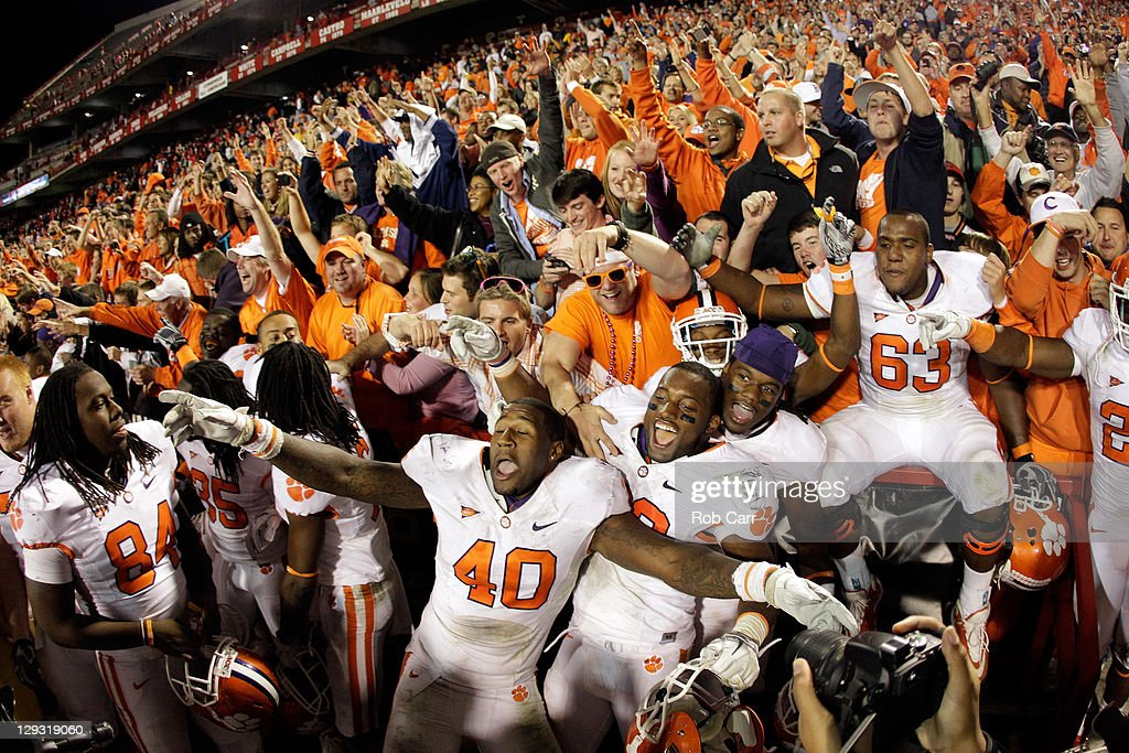 Andre Branch #40 and Corico Hawkins #42 (R) of the Clemson Tigers celebrate the Tigers' victory over the Maryland Terrapins at Byrd Stadium on October 15, 2011 in College Park, Maryland.