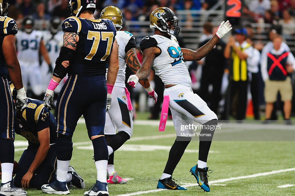 Andre Branch #90 of the Jacksonville Jaguars celebrates a sack against the St. Louis Rams at the Edward Jones Dome on October 6, 2013 in St. Louis, Missouri.