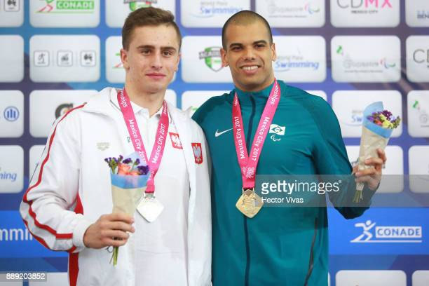 Andre Brasil of Brazil Gold Medal and Patryck Karlinski Silver Medal of Poland pose after men's 400 m Freestyle S10 Final during day 7 of the Para...