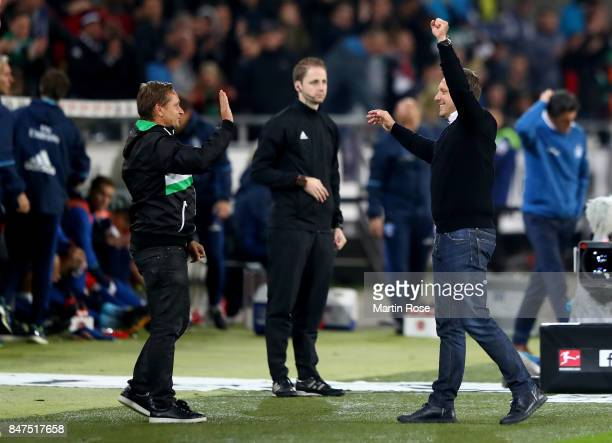 Andre Breitenreiter head coach of Hannover celebrate with sport director Horst Heldt the Bundesliga match between Hannover 96 and Hamburger SV at...