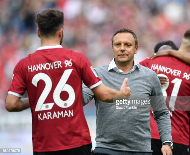 Andre Breitenreiter head coach of Hannover celebrates with Kenan Karaman at the end of the Second Bundesliga match between Hannover 96 and VfB...