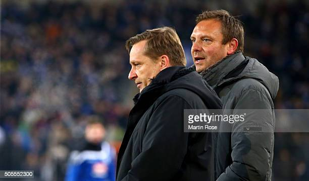 Andre Breitenreiter head coach of Schalke talks to manager Horst Heldt during the friendly match between Arminia Bielefeld and Schalke 04 at Schueco...