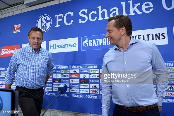 Andre Breitenreiter the newly appointed head coach of FC Schalke 04 and manager Horst Heldt attend a press conference at Veltins Arena on June 15...