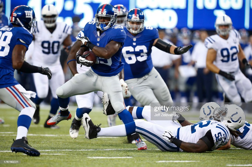 Andre Brown #35 of the New York Giants moves the ball against the Indianapolis Colts during their preseason game at MetLife Stadium on August 18, 2013 in East Rutherford, New Jersey.
