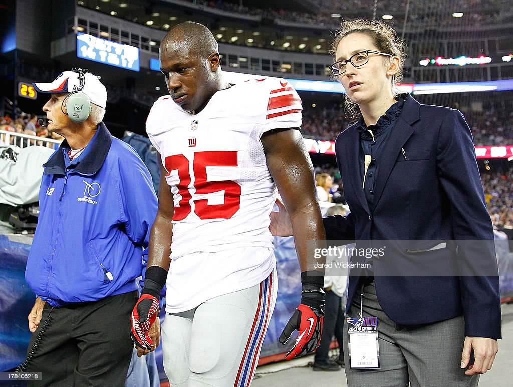 Andre Brown #35 of the New York Giants walks off of the field after breaking his leg against the New England Patriots during the preseason game at Gillette Stadium on August 29, 2013 in Foxboro, Massachusetts.