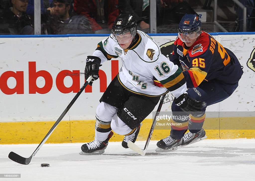 Andre Burakovsky #95 of the Erie Otters skates to check Max Domi #16 of the London Knights during an OHL game at the Budweiser Gardens on October 25, 2013 in London, Ontario, Canada. The Otters defeated the Knights 5-1.