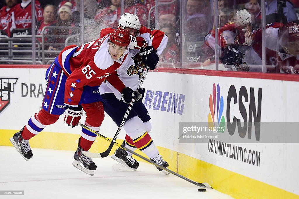 Andre Burakovsky #65 of the Washington Capitals battles for the puck against Steven Kampfer #3 of the Florida Panthers in the third period during their game at Verizon Center on February 2, 2016 in Washington, DC.