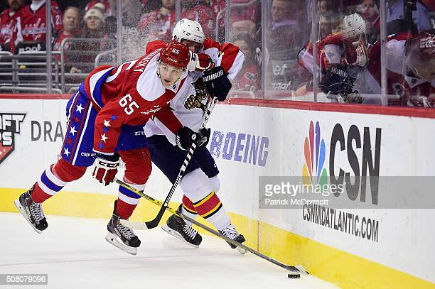 Andre Burakovsky of the Washington Capitals battles for the puck against Steven Kampfer of the Florida Panthers in the third period during their game...
