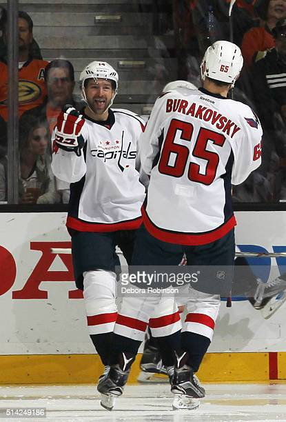 Andre Burakovsky of the Washington Capitals celebrates his gametying goal with Justin Williams of the Washington Capitals during the third period...