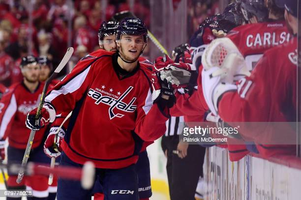 Andre Burakovsky of the Washington Capitals celebrates with his teammates after scoring a first period goal against the Pittsburgh Penguins in Game...