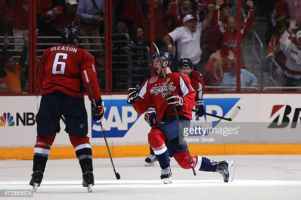 Andre Burakovsky of the Washington Capitals celebrates with teammates after scoring a goal against the New York Rangers during the second period in...