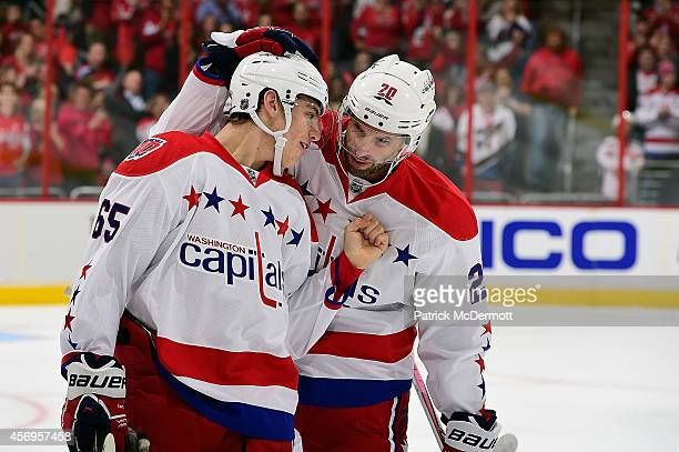 Andre Burakovsky of the Washington Capitals celebrates with Troy Brouwer after scoring his first career NHL goal in the first period against the...