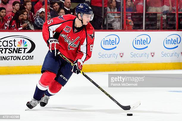Andre Burakovsky of the Washington Capitals controls the puck against the New York Rangers during the third period in Game Six of the Eastern...