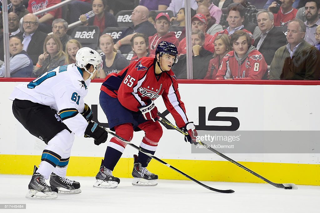 Andre Burakovsky #65 of the Washington Capitals controls the puck against Justin Braun #61 of the San Jose Sharks in the first period during an NHL game at Verizon Center on October 13, 2015 in Washington, DC.