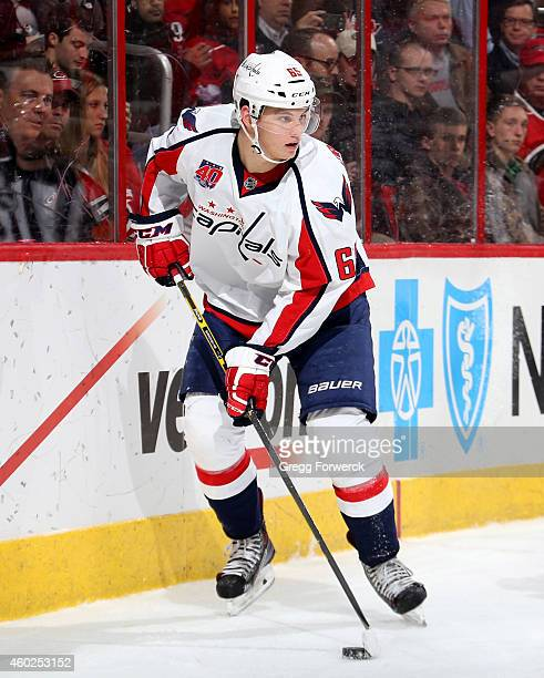 Andre Burakovsky of the Washington Capitals controls the puck along the boards during their NHL game against the Carolina Hurricanes at PNC Arena on...