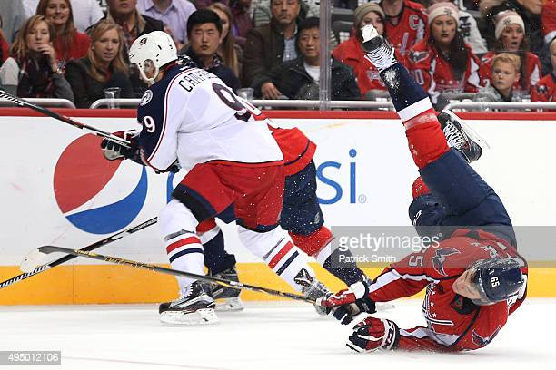 Andre Burakovsky of the Washington Capitals crashes to the ice after colliding with a teammate in the second period against the Columbus Blue Jackets...
