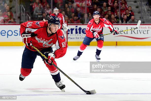 Andre Burakovsky of the Washington Capitals moves the puck up ice in the first period against the Calgary Flames during an NHL game at Verizon Center...