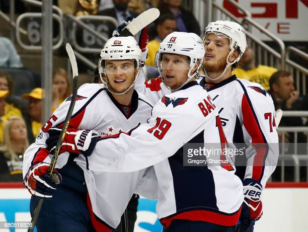 Andre Burakovsky of the Washington Capitals reacts after scoring a goal against the Pittsburgh Penguins with Nicklas Backstrom and John Carlson in...