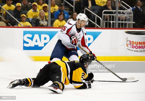 Andre Burakovsky of the Washington Capitals skates against Chad Ruhwedel of the Pittsburgh Penguins in Game Six of the Eastern Conference Second...
