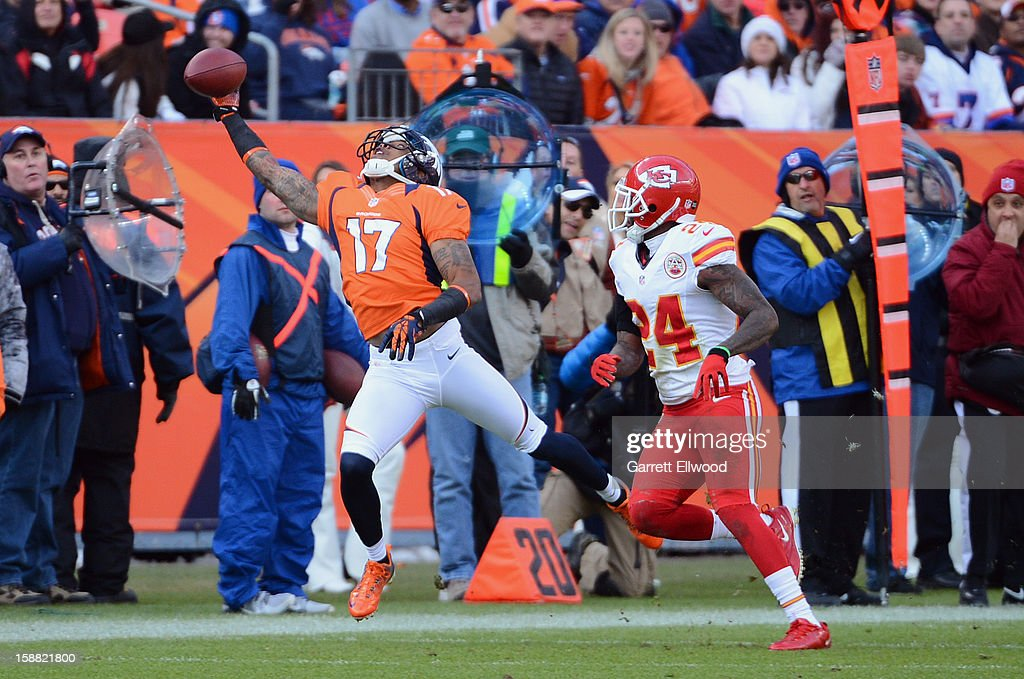 Andre Caldwell #17 of the Denver Broncos reaches out for a pass against Brandon Flowers #24 of the Kansas City Chiefs during the game at Sports Authority Field at Mile High on December 30, 2012 in Denver, Colorado.
