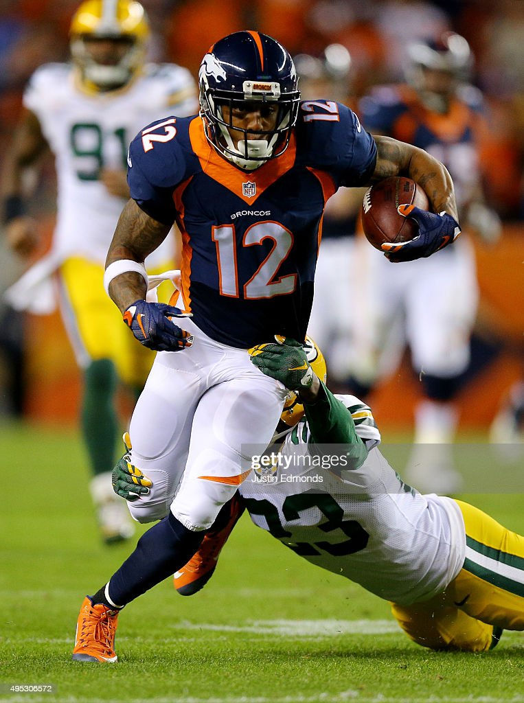 Andre Caldwell #12 of the Denver Broncos runs the ball for a first down against Damarious Randall #23 of the Green Bay Packers in the third quarter at Sports Authority Field at Mile High on November 1, 2015 in Denver, Colorado.