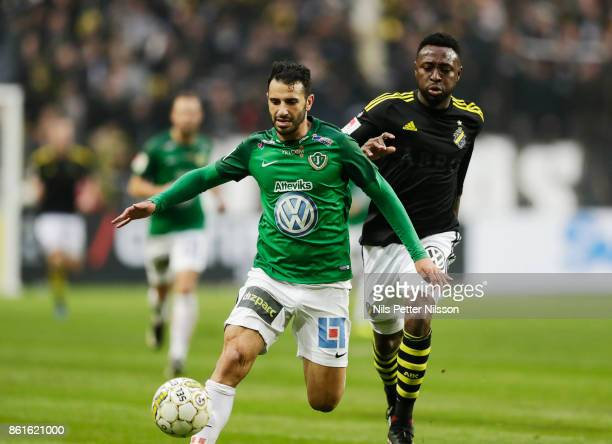 Andre Calisir of Jonkopings Sodra and Chinedu Obasi of AIK competes for the ball during the Allsvenskan match between AIK and Jonkopings Sodra IF at...