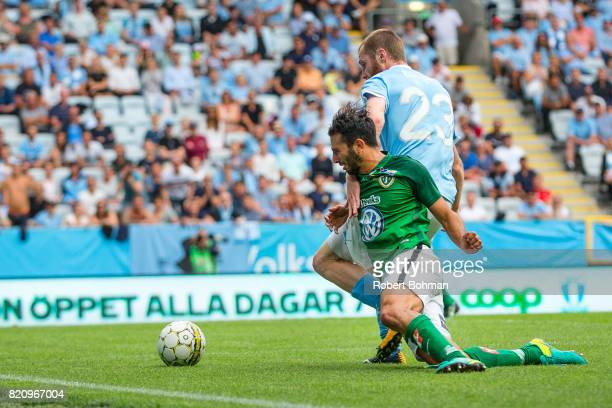 Andre Calisir of Jonkopings Sodra and Jo Inge Berget of Malmo FF during the Allsvenskan match between Malmo FF and Jonkopings Sodra IF at Swedbank...