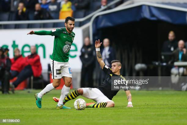 Andre Calisir of Jonkopings Sodra and Nicolas Stefanelli of AIK during the Allsvenskan match between AIK and Jonkopings Sodra IF at Friends Arena on...