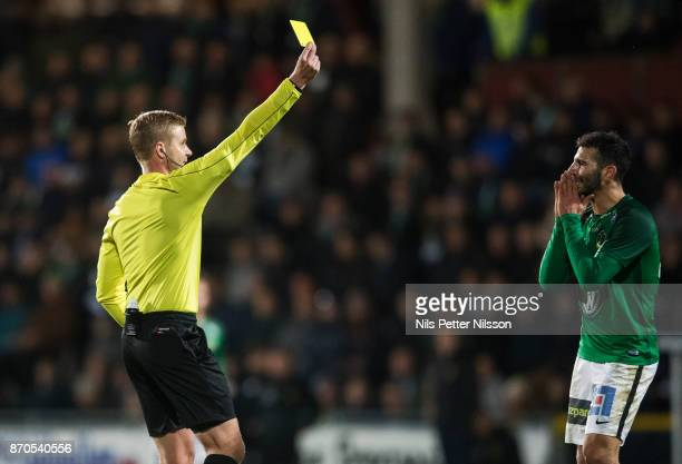 Andre Calisir of Jonkopings Sodra is shown a yellow card by Glenn Nyberg referee during the Allsvenskan match between Jonkopings Sodra IF and...
