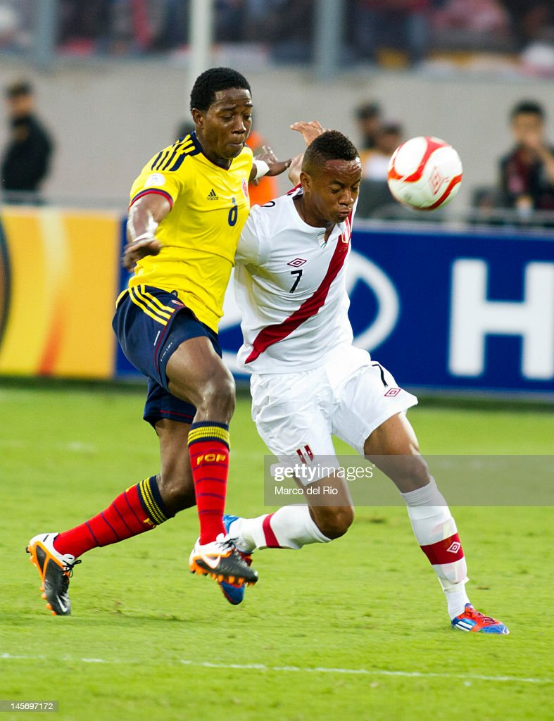 Andre Carrillo from Peru fights for the ball with Carlos Sanchez from Colombia during the match between Peru and Colombia at Estadio Nacional stadium during the fifth round of the South American Qualifiers for the FIFA Brazil 2014 World Cup on June 03, 2012 in Lima, Peru.