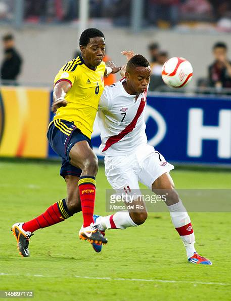 Andre Carrillo from Peru fights for the ball with Carlos Sanchez from Colombia during the match between Peru and Colombia at Estadio Nacional stadium...