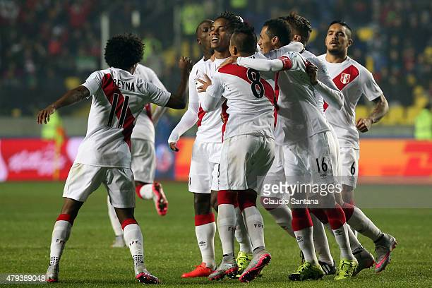 Andre Carrillo of Peru celebrates with teammates after scoring the opening goal during the 2015 Copa America Chile Third Place Playoff match between...