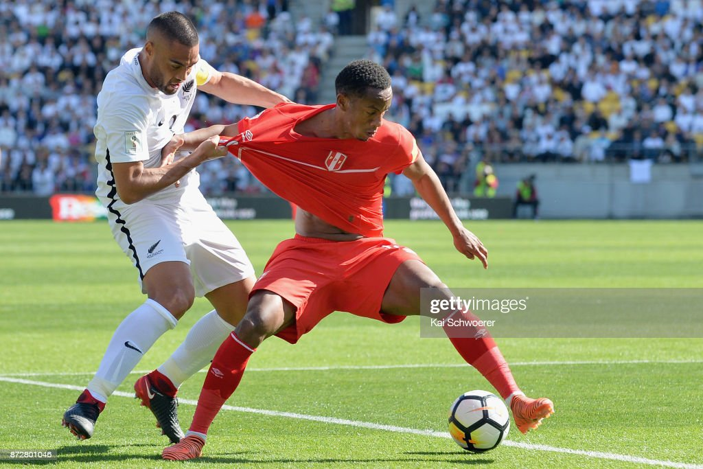 Andre Carrillo of Peru controls the ball from Winston Reid of the All Whites during the 2018 FIFA World Cup Qualifier match between the New Zealand All Whites and Peru at Westpac Stadium on November 11, 2017 in Wellington, New Zealand.