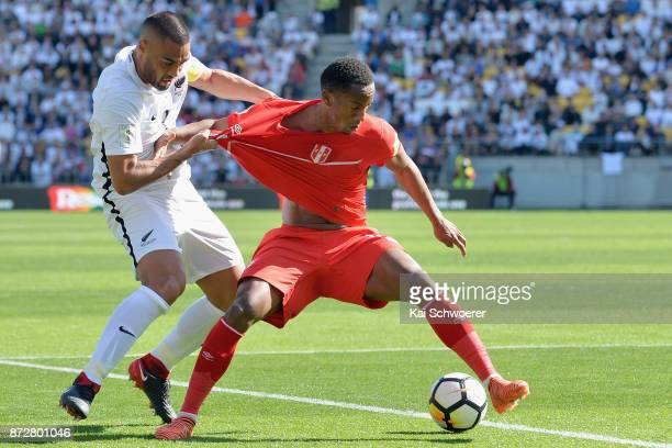 Andre Carrillo of Peru controls the ball from Winston Reid of the All Whites during the 2018 FIFA World Cup Qualifier match between the New Zealand...
