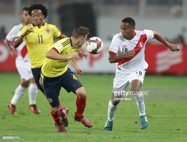 Andre Carrillo of Peru fighs for the ball with Santiago Arias of Colombia during a match between Peru and Colombia as part of FIFA 2018 World Cup...