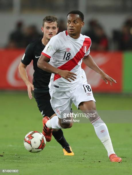 Andre Carrillo of Peru fights for the ball with Marco Rojas of New Zealand during a second leg match between Peru and New Zealand as part of the 2018...