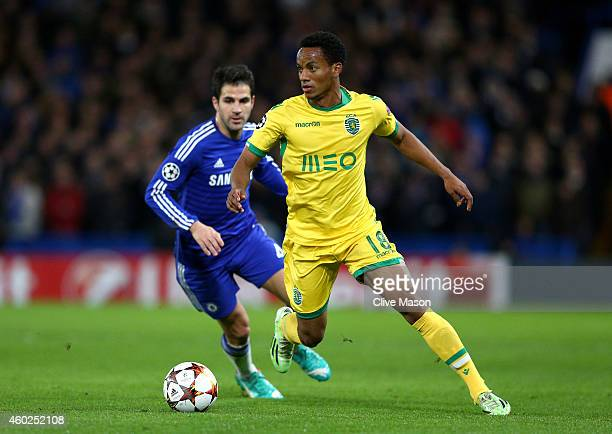 Andre Carrillo of Sporting Lisbon is closed down by Cesc Fabregas of Chelsea during the UEFA Champions League group G match between Chelsea and...