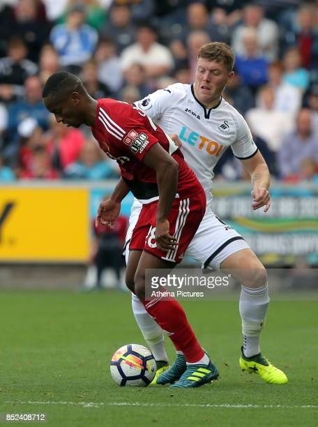 Andre Carrillo of Watford challenged by Alfie Mawson of Swansea City during the Premier League match between Swansea City and Watford at The Liberty...